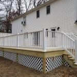 New wood deck with RDI Endurance railings and privacy wall in Flanders, NJ.