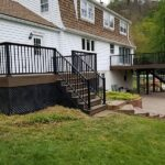 Two new Trex Transcend in Spiced Rum Decks & Trex Signature Aluminum Railings with a solid Deck board as a Cocktail Railing cap on Lake Mohawk in Sparta, NJ.