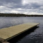 Here's an old Cantilever Dock that we demoed then applied a Rust inhibitor and protective Enamel on the Steel Frame. Rebuilt the Wood frame. Then Installed new Pressure Treated Decking in Lake Hopatcong, NJ.