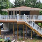 Another beautiful Trex Deck with Havana Gold Decking and White RDI Endurance Railings built in Sussex County in Fredon, NJ.