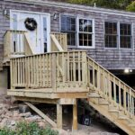 Out with the old and in with the new Pressure Treated Wood Decking & Railings on this multi-level front Porch in Byram, NJ.