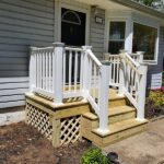 Before & after pics of a new Wood front Porch with RDI Endurance Vinyl Railings in Hopatcong, NJ.
