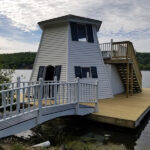 This lighthouse/boathouse on Lake Mohawk needed a lot of love and attention. Frame adjustments, bridge, siding, soffits, windows repaired with new Decking & new Steps installed. Midnight blue and white stain applied on the bridge in Sparta, NJ.