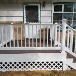 Another unusable front porch transformed into a new Trex Transcend Porch in Spiced Rum Decking with white RDI Endurance Railings in Washington, NJ.