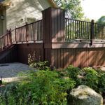 Extending this Decks life Pressure washed then applied Olympic Stain in Royal Mahogany. Pressure washing Stain Deck Dock in Fredon, NJ.