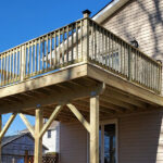 This Deck was is in bad shape and not safe. Here is their new Pressure Treated Wood deck with cocktail Railings ready for use in Jefferson, NJ.