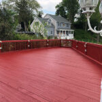 Multiple Deck repairs made, pressure washing and solid stain in Navajo Red applied.