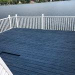 Bringing new life to this Boathouse Deck on Lake Mohawk with multiple repairs made, pressure washing with Olympic Elite White and Midnight Blue solid Stain applied in Sparta, NJ.