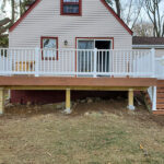Ho Ho Ho, did you know we Build Decks in the snow? Check out this new Trex Transcend Deck with Tiki torch Decking & white RDI Endurance Railings in Denville, NJ.